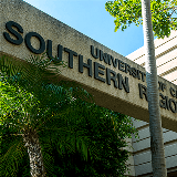 Angled view of the Southern Regional Library building sign in the courtyard